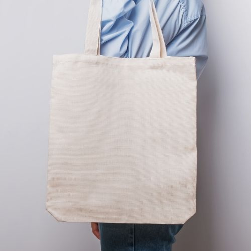 person is holding tote bag on their shoulder