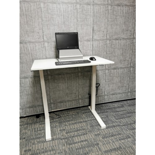 Compact Home Office White Sit Stand Desk. Powered by an electric motor with a built-in digital control panel