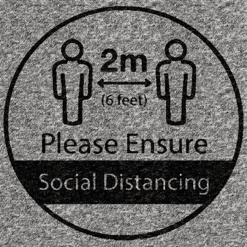Social distance message on Grey floor tile