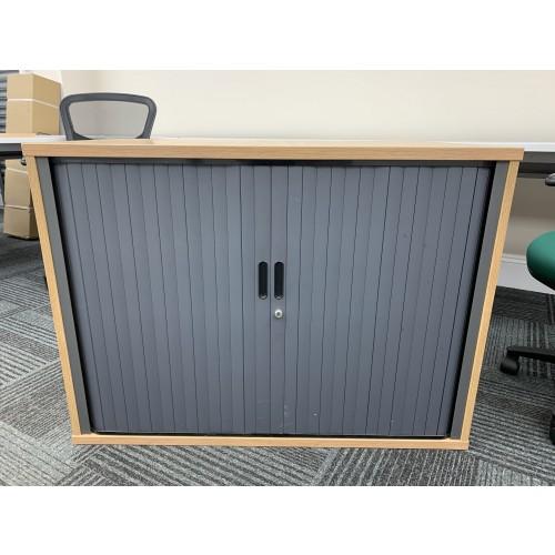 Side Opening Tambour Cupboard, In Limed Oak Finish. 730mm High x 1000mm Width x 600mm Depth. 1 In Stock